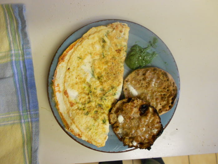 The finished omelet shown here with a whole wheat english muffin and a dollop of mint chutney.
