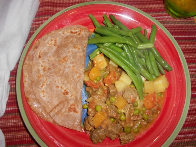 Serving suggestion with steamed green beans and whole wheat chapati.