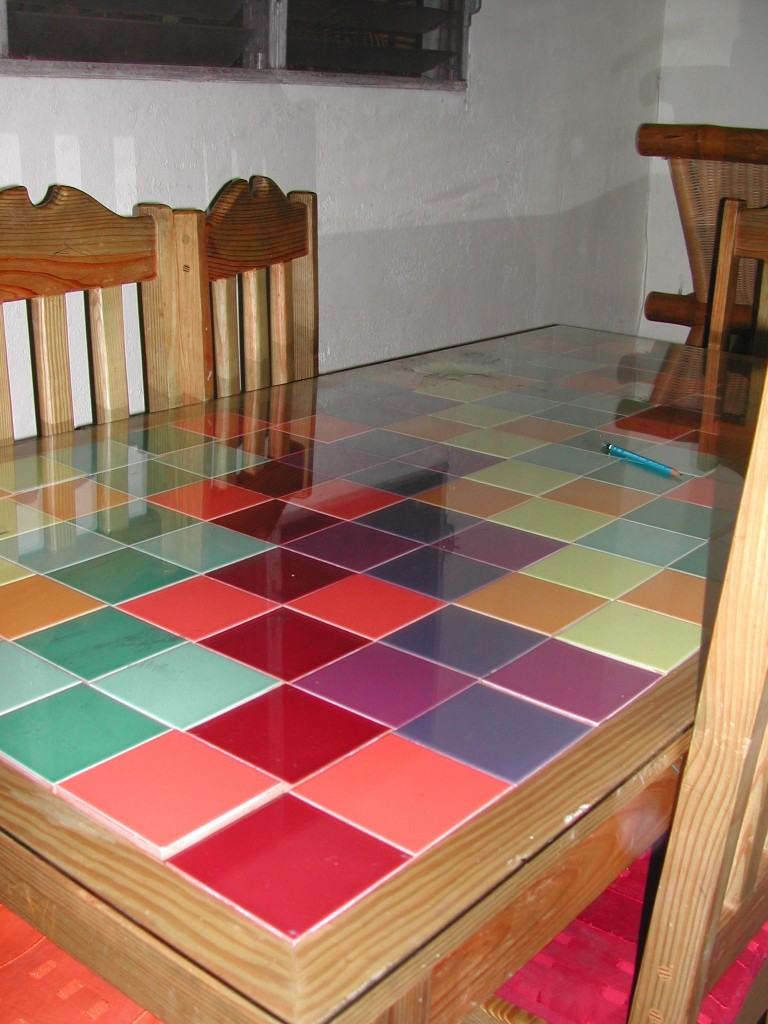 I designed this table with interchangeable tiles.